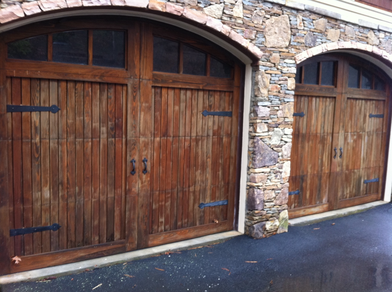 Natural wood look on garage doors through graining lower for Wood looking garage doors
